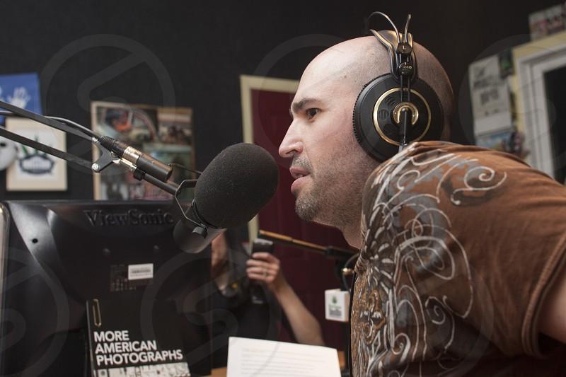 Announcer doing live broadcast on community radio in Denver Colorado photo