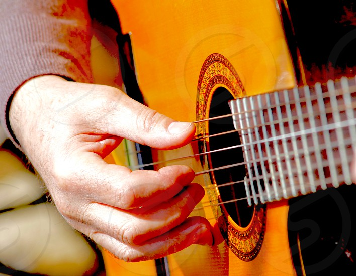 A man hand playing guitar instrument music activity artistic photo