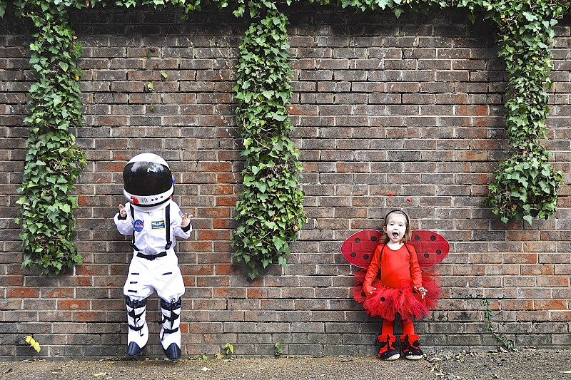 Kids halloween costume spaceman and butterfly siblings photo