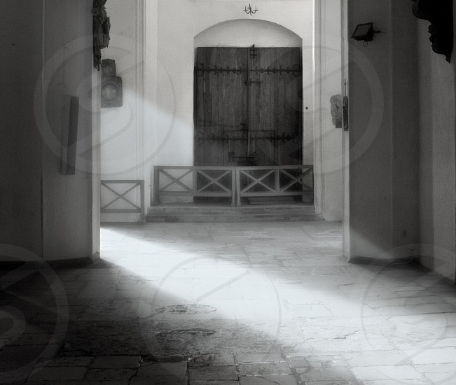 black and white photograph of a wooden door photo
