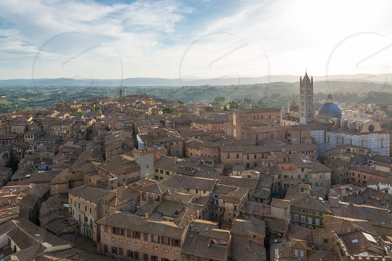 Top aerial panoramic skyline view of old town Siena Italy. photo