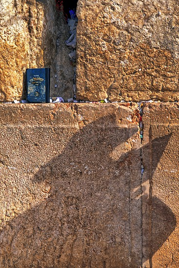 A Rabbi prays at the Western Wall in Jerusalem Israel. photo