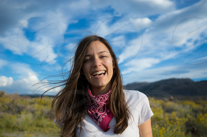 Girl laughing in a field on a beautiful day photo
