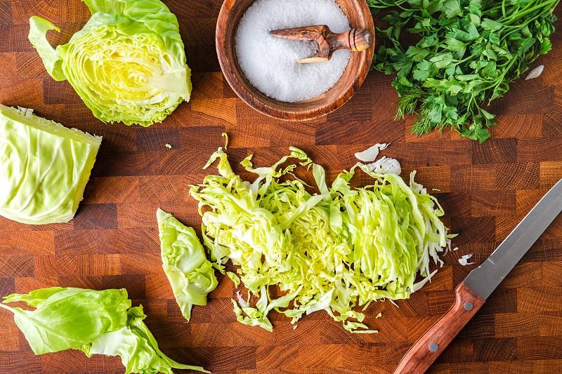 Cutting raw green cabbage on a cutting board  photo
