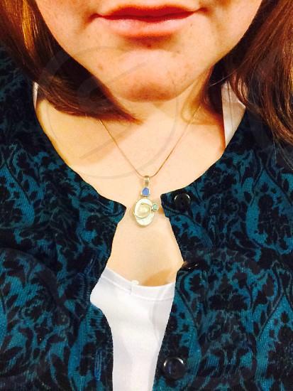 Necklace neck skin cardigan blue ginger face.  photo
