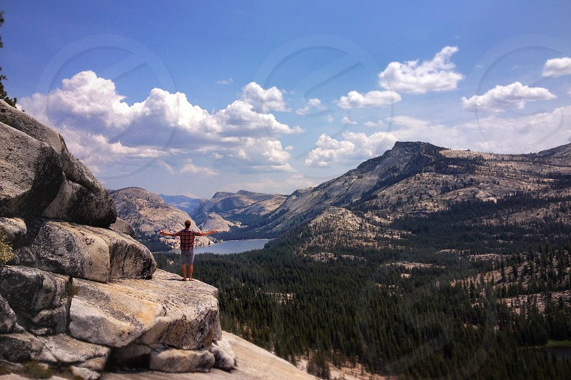 man standing on a rocky mountain photo