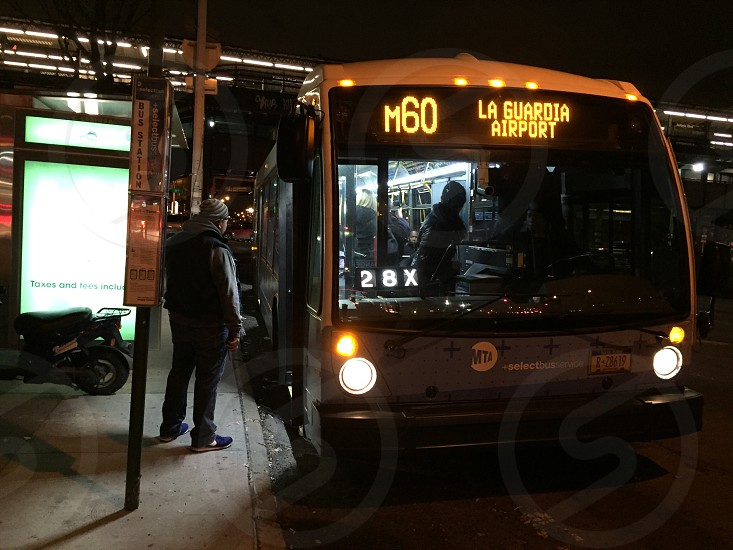 person standing near the door of the bus photo