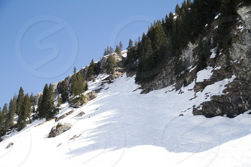 Mountain snow ski people lift pist sky cloud avoriaz trees sun sky photo