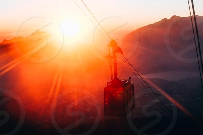 sunset burst beam mountains lift Italy photo