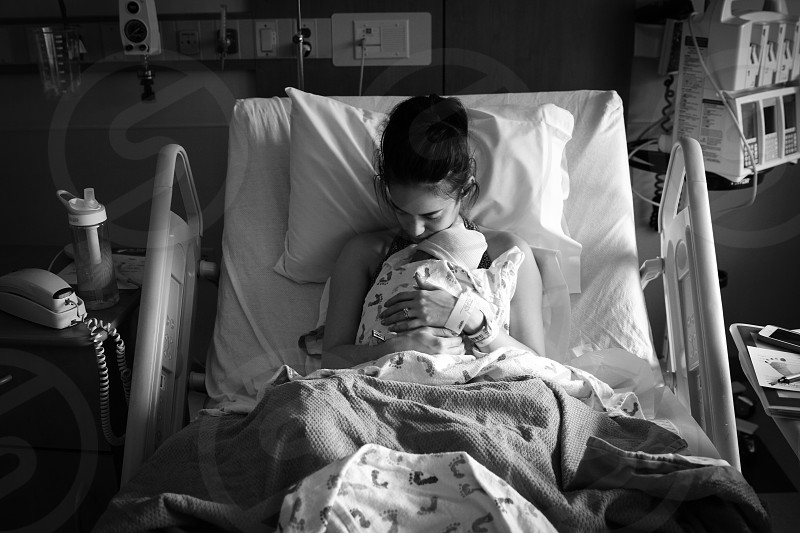 New mom in the hospital with her new baby. photo