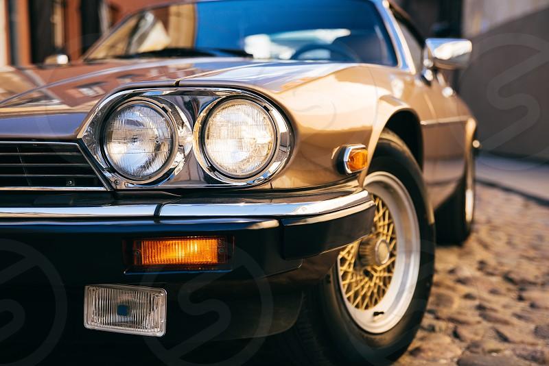Round healights of classic Jaguar car photo