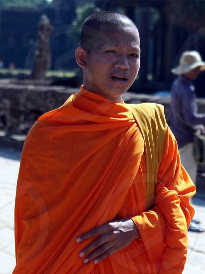 monk wearing orange suit during daytime photo