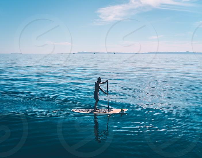 ocean man water blue paddle board photo