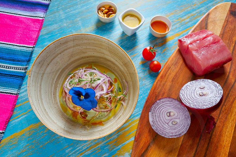 Fish ceviche latin preuvian recipe on bowl with pansy flower photo