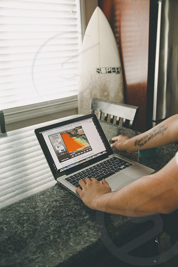 man standing in front of laptop photo