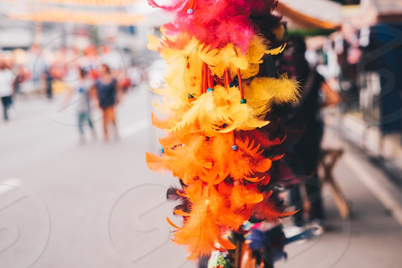 Feather hair accessory in display during festival photo