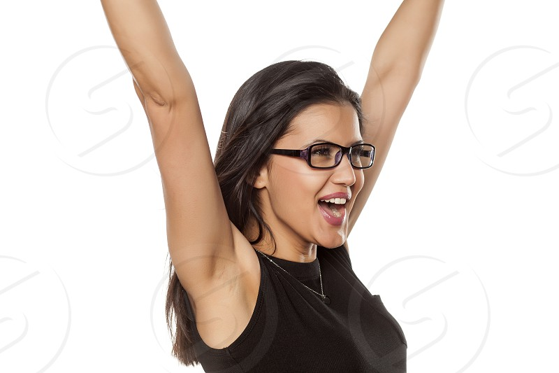 happy beautiful young woman with glasses photo