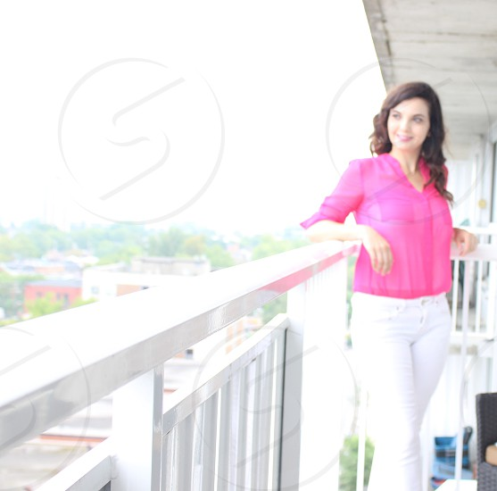 Fashion apartment balcony city woman pink  photo