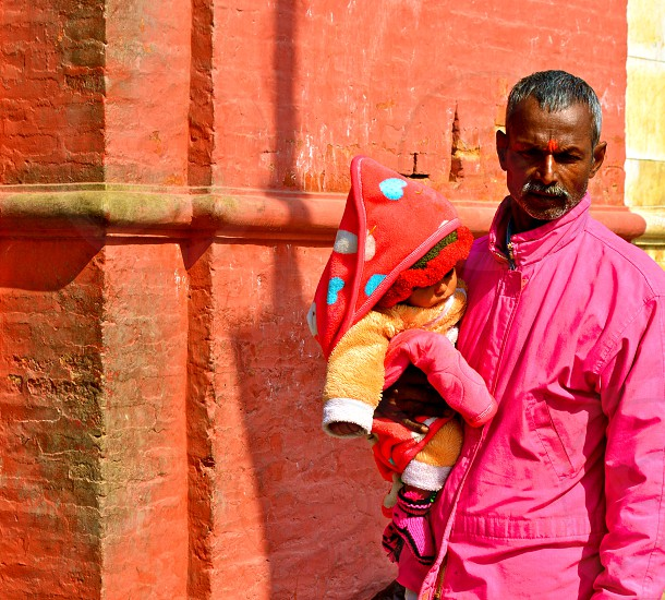 Color Love - Grandfather and daughter at a holy temple in Kathmandu Nepal. photo