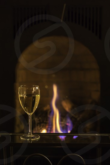 wine by the fireplace photo