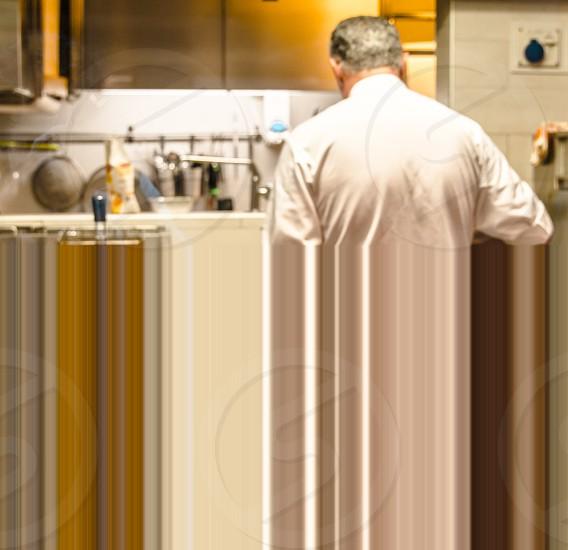 Chef Cooking Food In Restaurant Hotel Kitchen photo