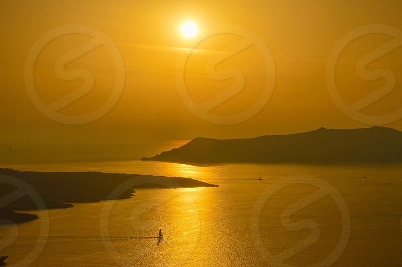 Scenic view od the Caldera of Santorini during sunset photo