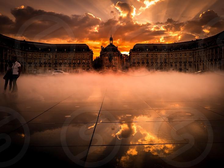 BORDEAUX/FRANCE - SEPTEMBER 20 : Miroir d'Eau at Place de la Bourse in Bordeaux France on September 20 2016. Unidentified people photo