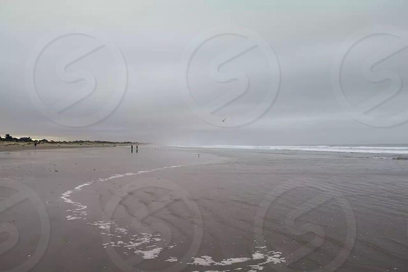 white sea waves on the seashore photo