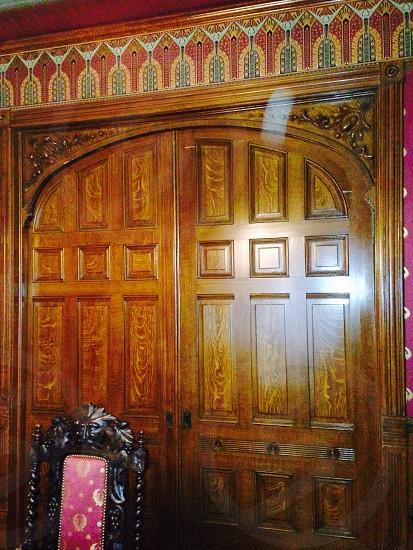 chair near wooden door photo