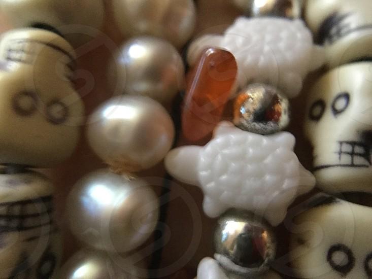 Beads bracelet jewelry white red stone turtle skull macro closeup detail  photo