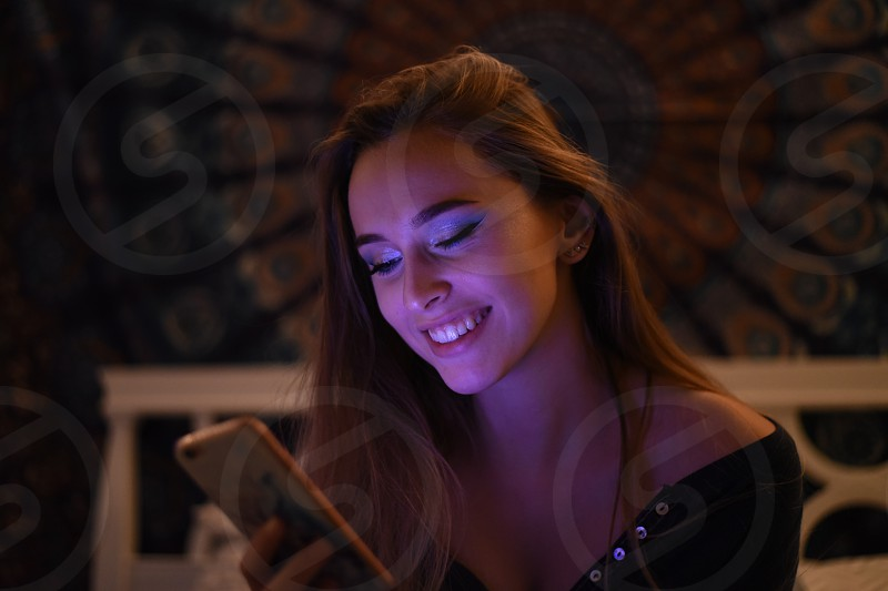 Young woman using Smartphone photo