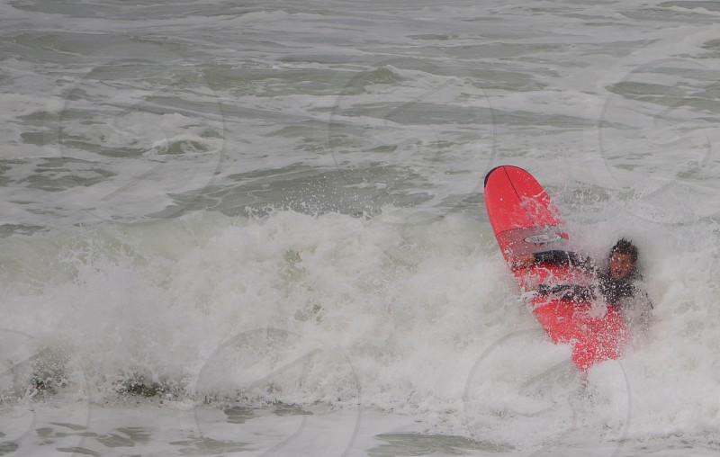 Surfer crashing ocean determination photo