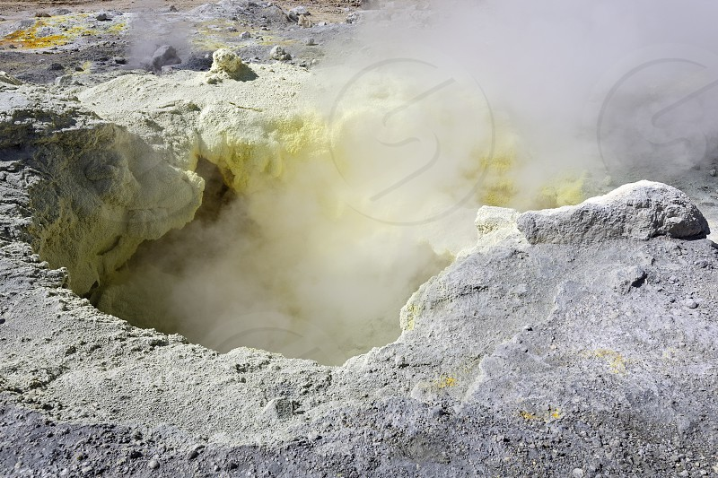 Nature of Kamchatka: sulfur fumarole in crater active Mutnovsky Volcano. Russia Far East Kamchatka Peninsula. photo