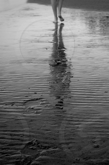 Walking on the shore at low tide rippled reflection photo