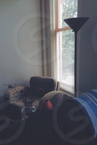 grey lounge chair near window photo