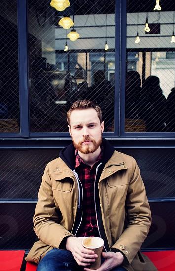 men's brown zipped up jacket photo