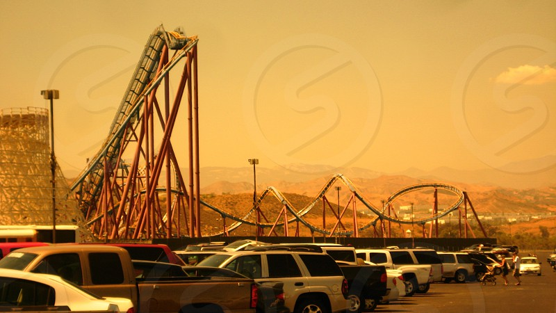cars parked near amusement park photo