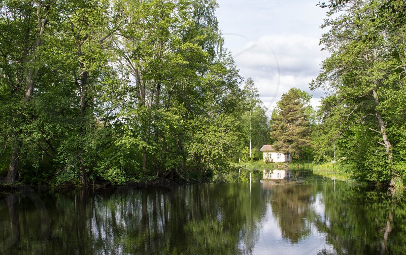 Small Swedish home by a lake in Langvindsbruk Sweden photo