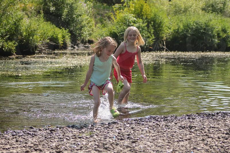 girls playing in water photo
