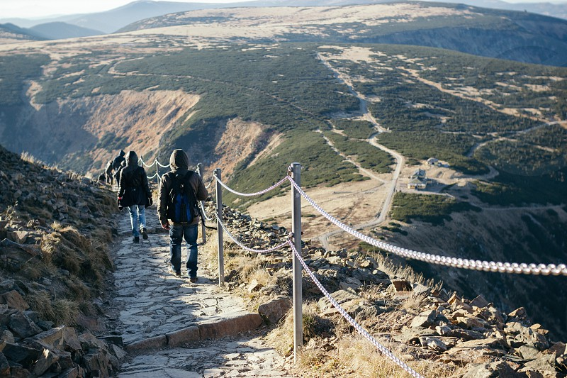 People walk down the path from the top of Sniezka mountain in Karpacz photo