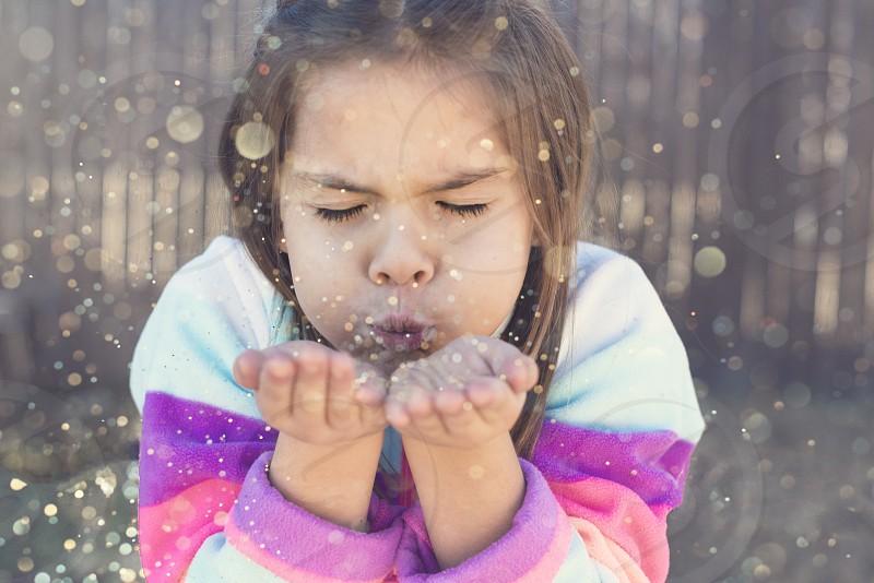 Blowing glitter photo
