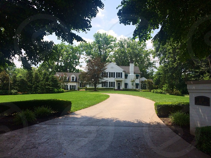 White house black shutters driveway colonial  photo