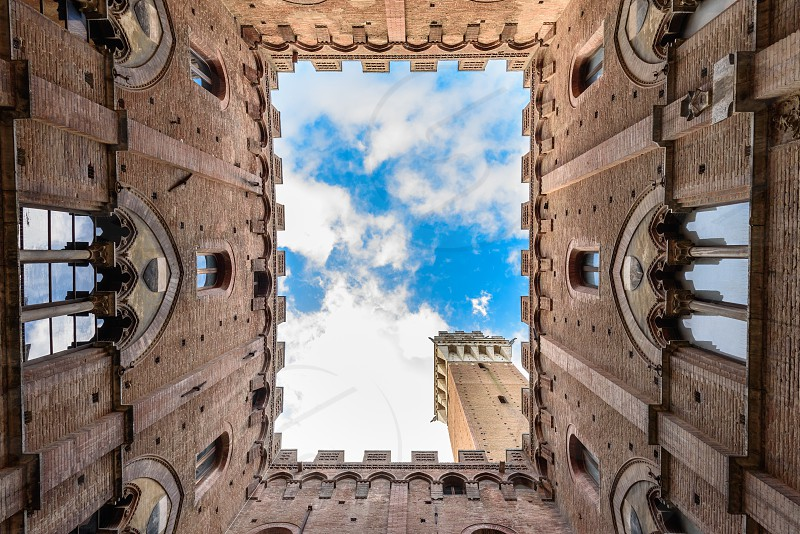 """View of the historical """"Torre del Mangia"""" in Siena from the courtyard of the Town Hall photo"""