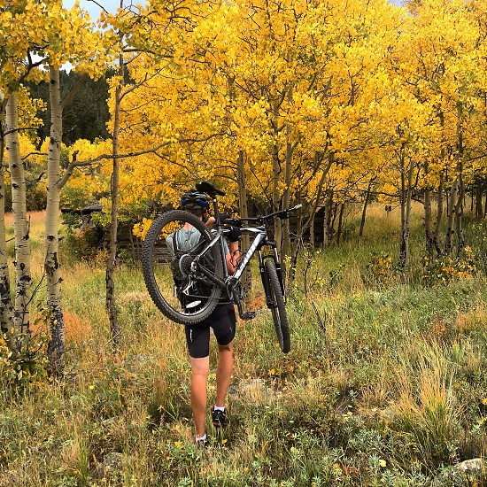 Hike-a-bike through the aspens to a log cabin for when the bike trails don't take you far enough! photo