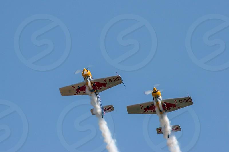 Red Bull Stunt Planes at the Shoreham Airshow Making Smoke photo