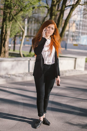 Young woman talking on the telephone  photo