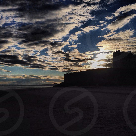Castle silhouette from the beach. Broughty Ferry Scotland.  photo