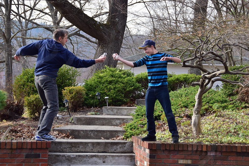 Father Son Pretend Sword fight Front Steps photo
