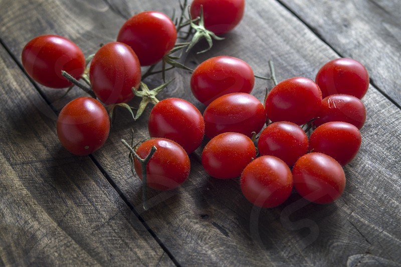 Cherry Tomato on wooden table photo