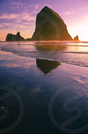 rock formation on the beach photo